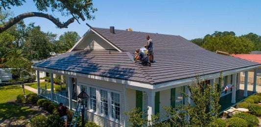 Workers installing a metal roof in Cut Off, Louisiana, on Today's Homeowner