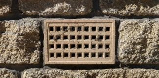 Crawl space vent, as seen on a brick home