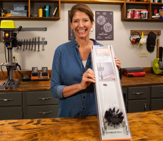 """""""Today's Homeowner"""" Best New Products host Jodi Marks, displaying the Everbilt duct cleaner in her workshop"""
