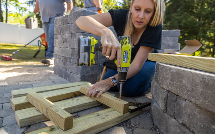 """""""Today's Homeowner"""" co-host Chelsea Lipford Wolf drills decking screws into wood cleats"""