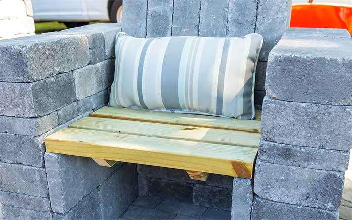 Closeup of a Pavestone paver chair with a lumbar pillow
