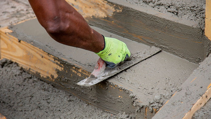 Using a concrete float on a freshly poured concrete steps